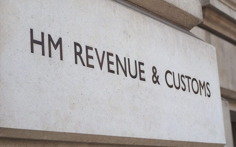 a printing of the HMRC logo on a building, presumably their headquarters where they deal with taxation services