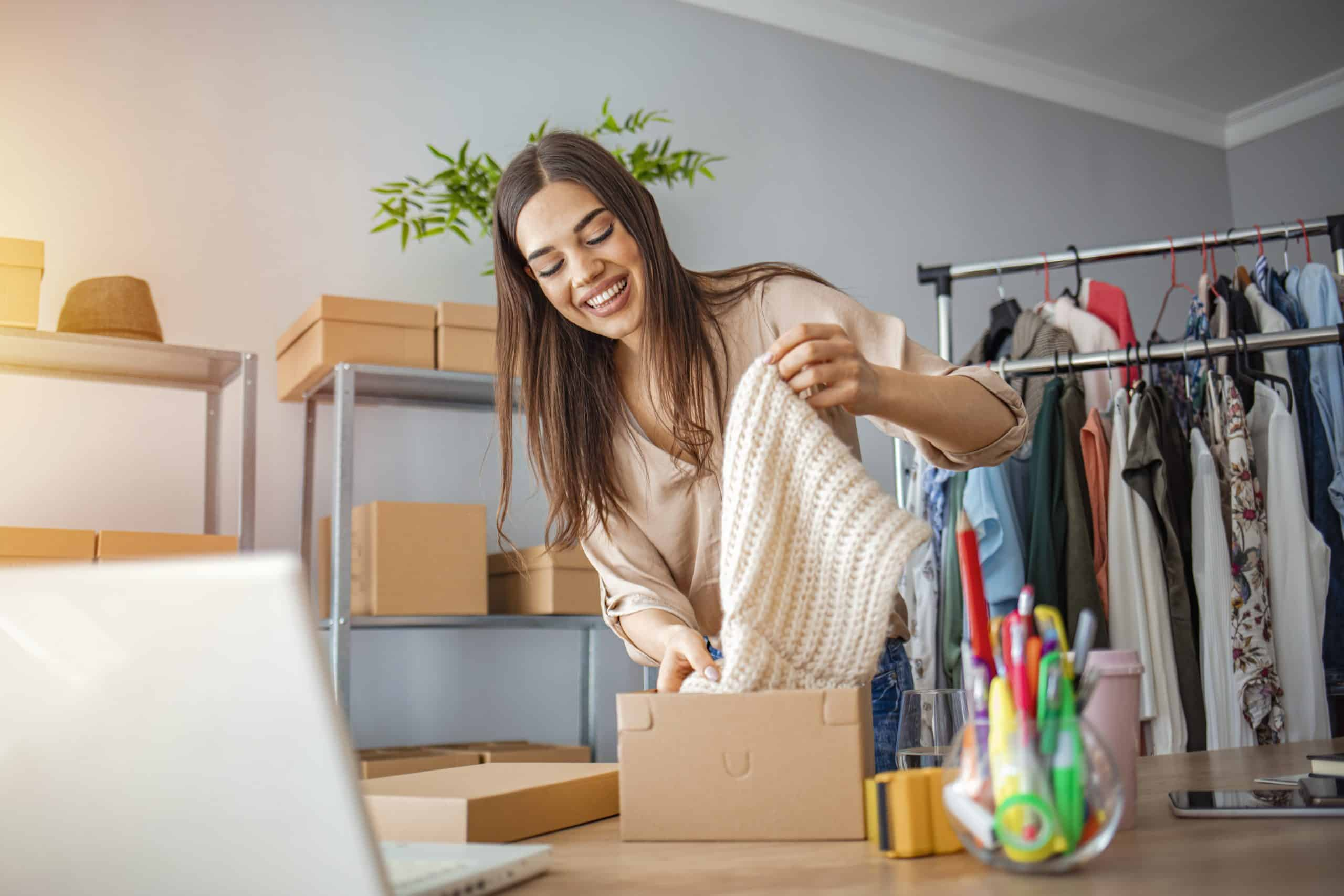 Young woman selling products online and packaging goods for shipping. She is representavie of the SME owners that the Amazon launchpad startup of the year award is trying to celebrate