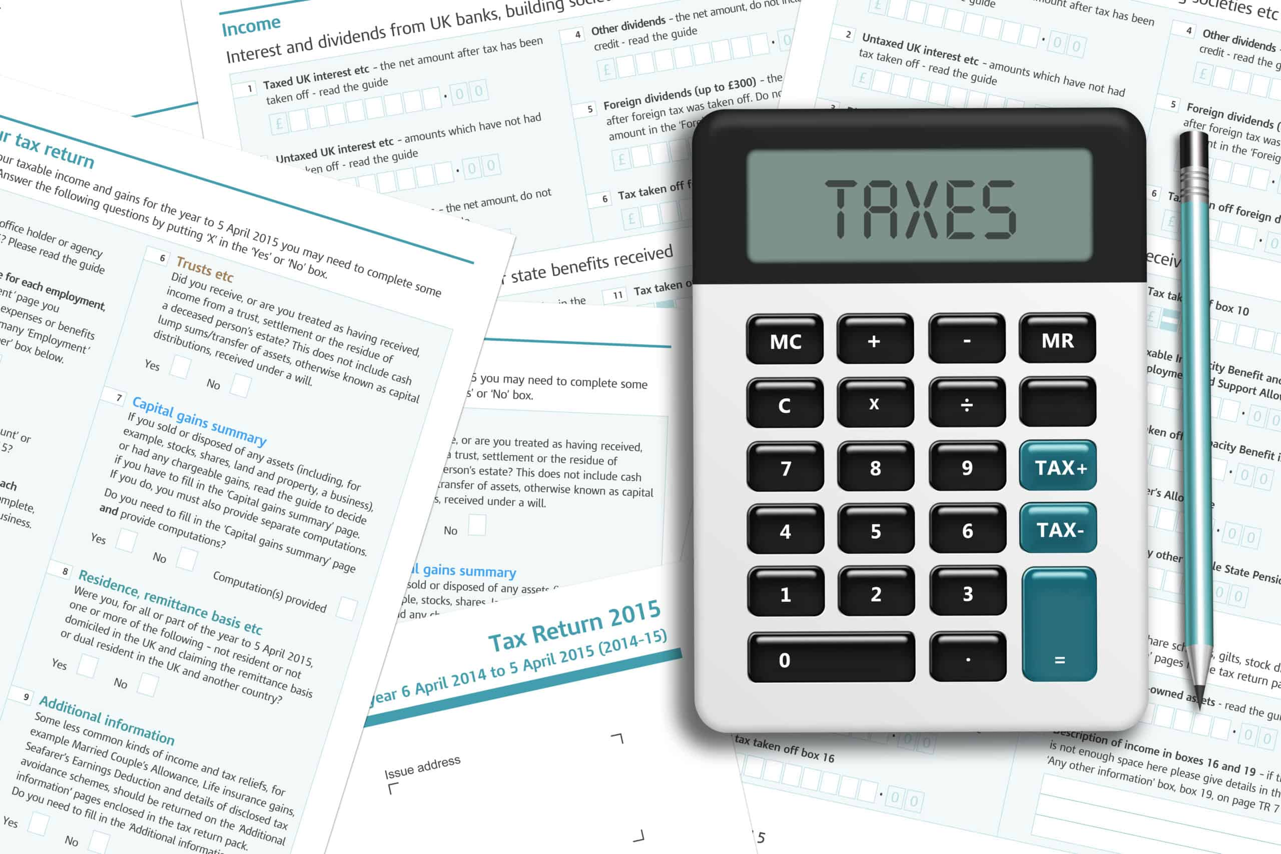 UK tax form with calculator lying on wooden desk as businesses consider business rates in preparation of the upcoming Autumn budge